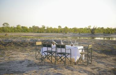 Experience dinner out in the open, with the sounds and views of the African bush
